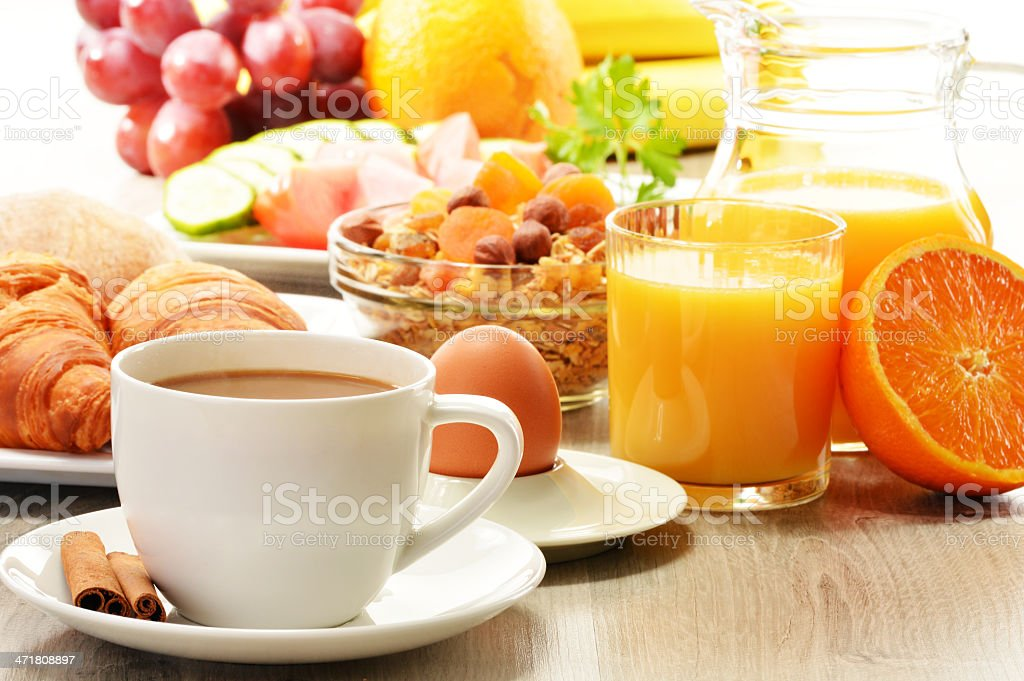 Breakfast including coffee, bread, orange juice, muesli and fruits royalty-free stock photo