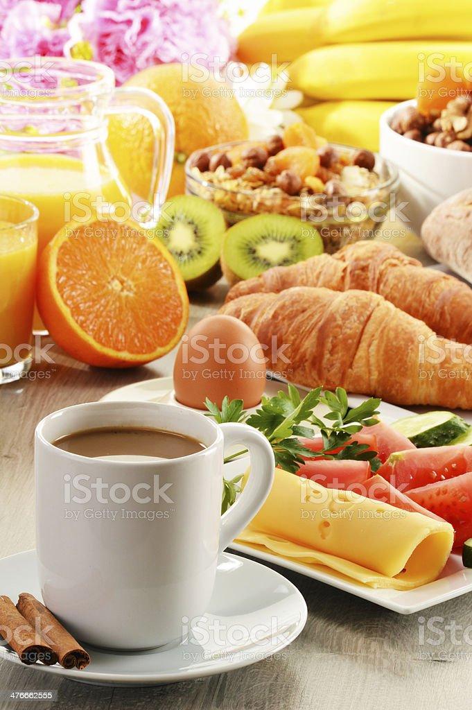 Breakfast including coffee, bread, orange juice, muesli and fruits royalty-free stock photo