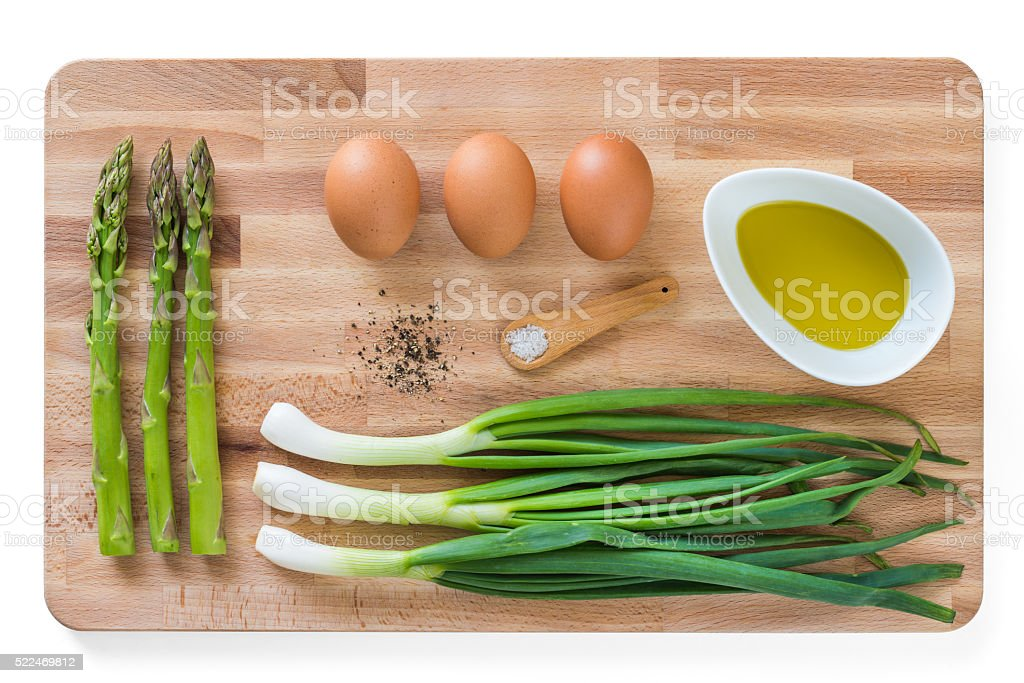 Breakfast ingredients on wooden cutting plate stock photo