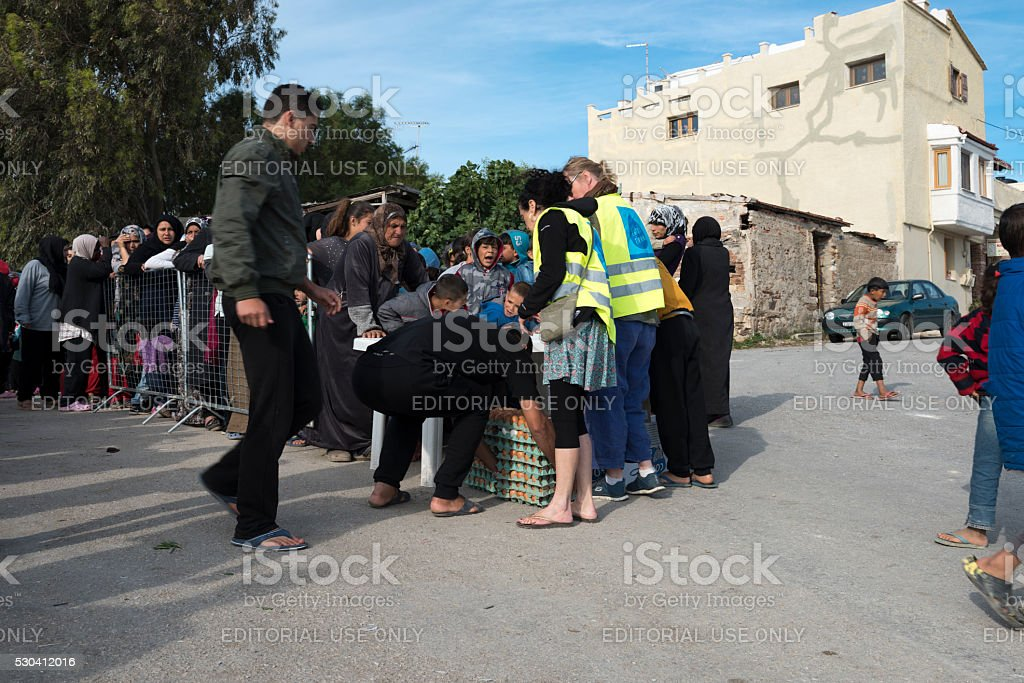 Breakfast line in Souda refugee camp on Greek Island Chios stock photo