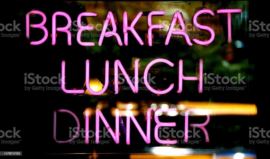 Breakfast Lunch and Dinner Neon Sign stock photo