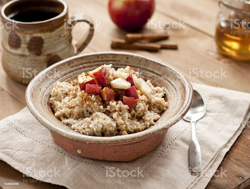 Breakfast made of oatmeal with apples, honey and cinnamon  stock photo