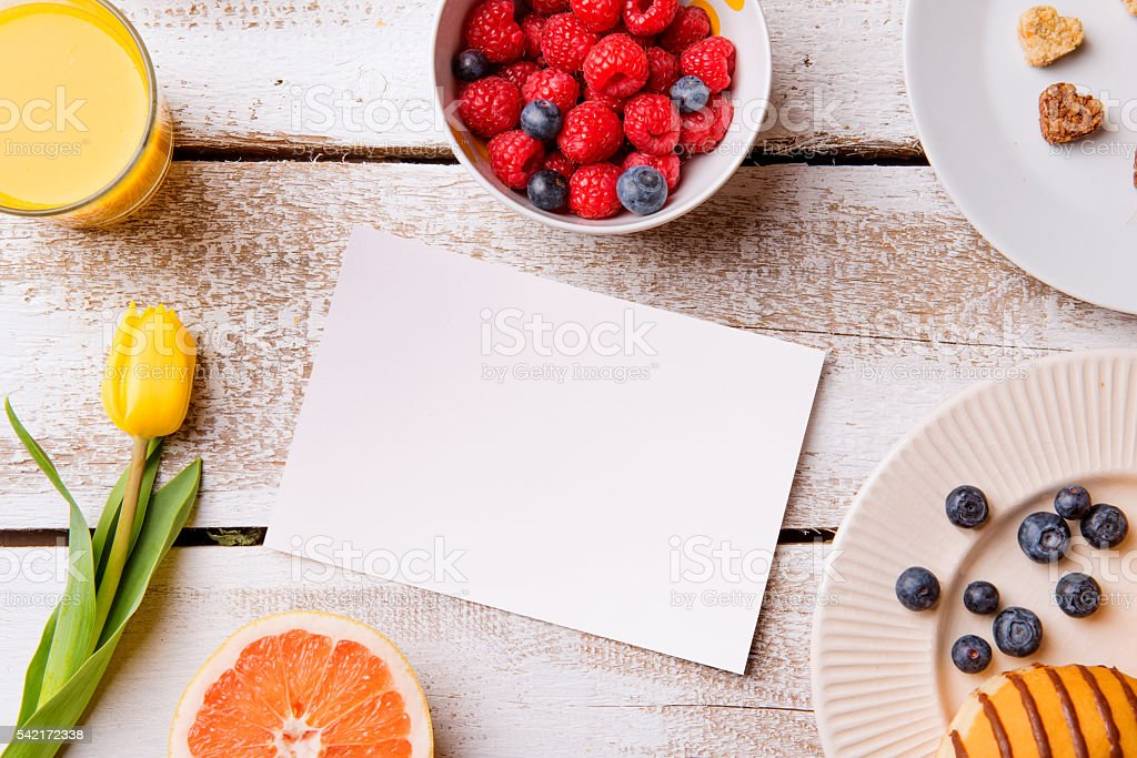 Breakfast meal. Empty greeting card. Studio shot, wooden backgro stock photo