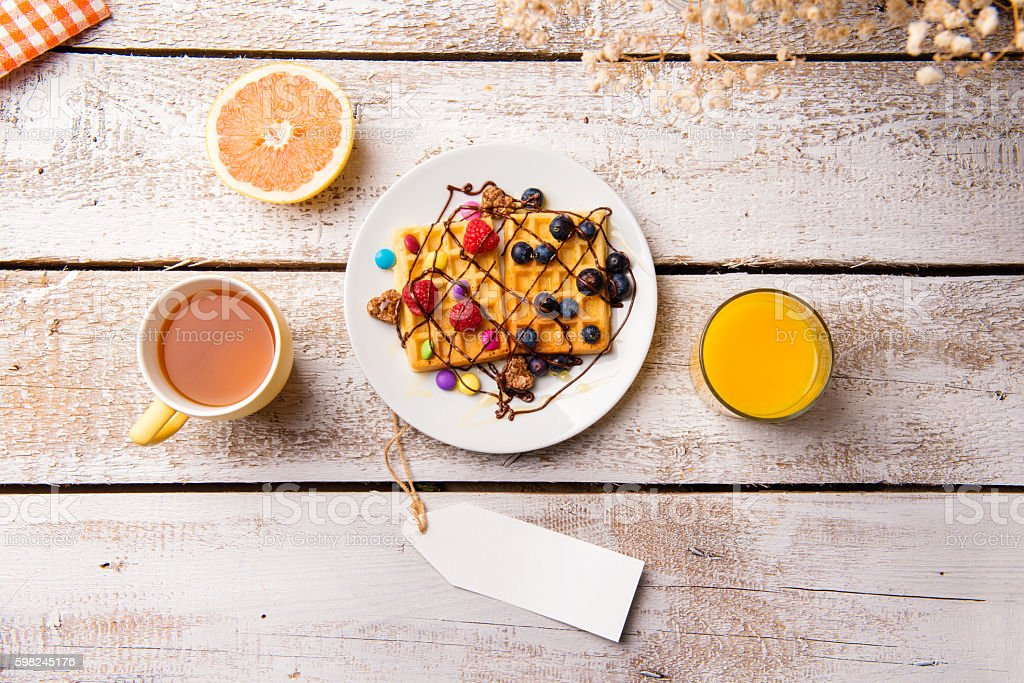Breakfast meal. Empty tag. Studio shot on wooden background. stock photo