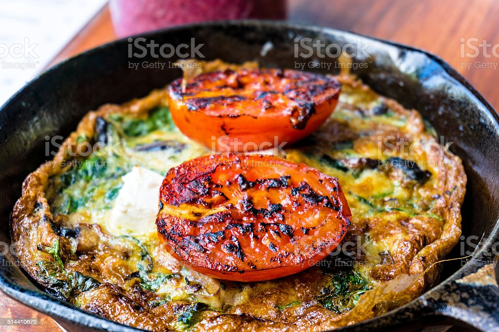 Breakfast meal, omelette with greens and tomato stock photo