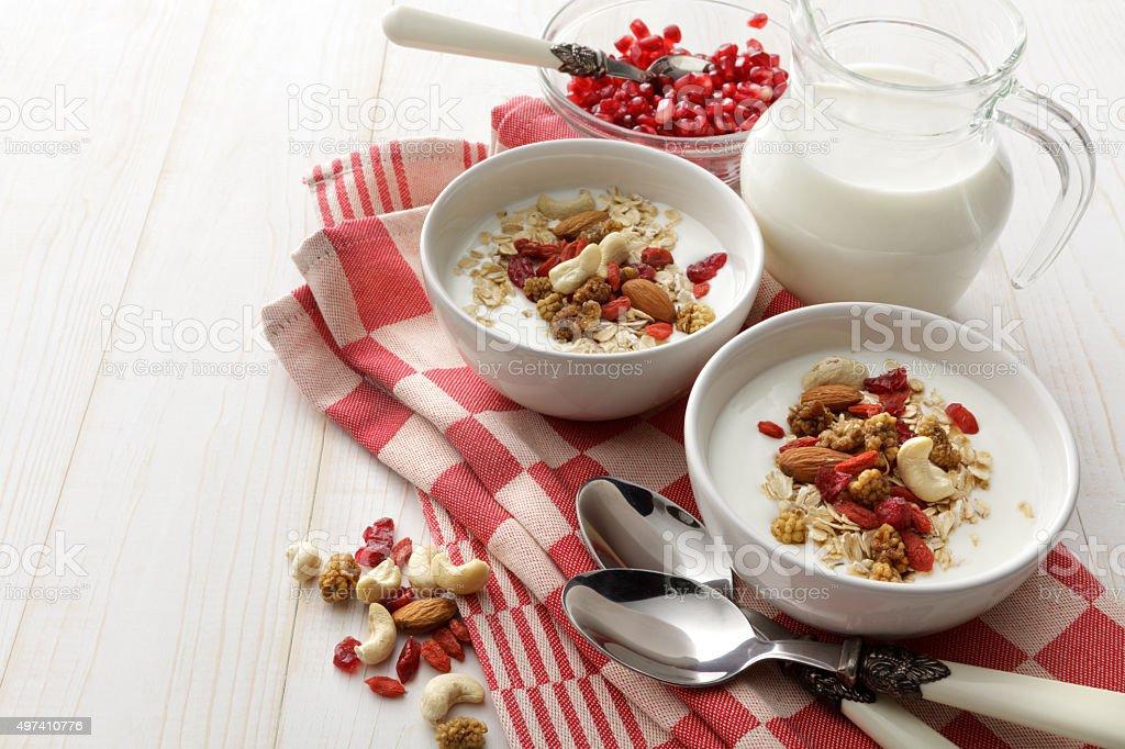 Breakfast: Muesli, Pomegranate and Yogurt stock photo