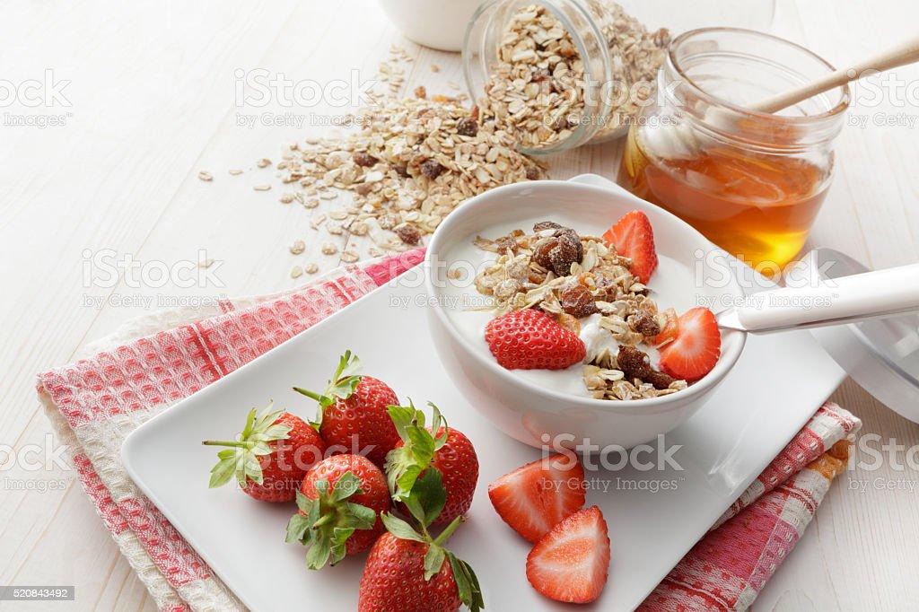 Breakfast: Muesli, Strawberries and Honey Still Life stock photo