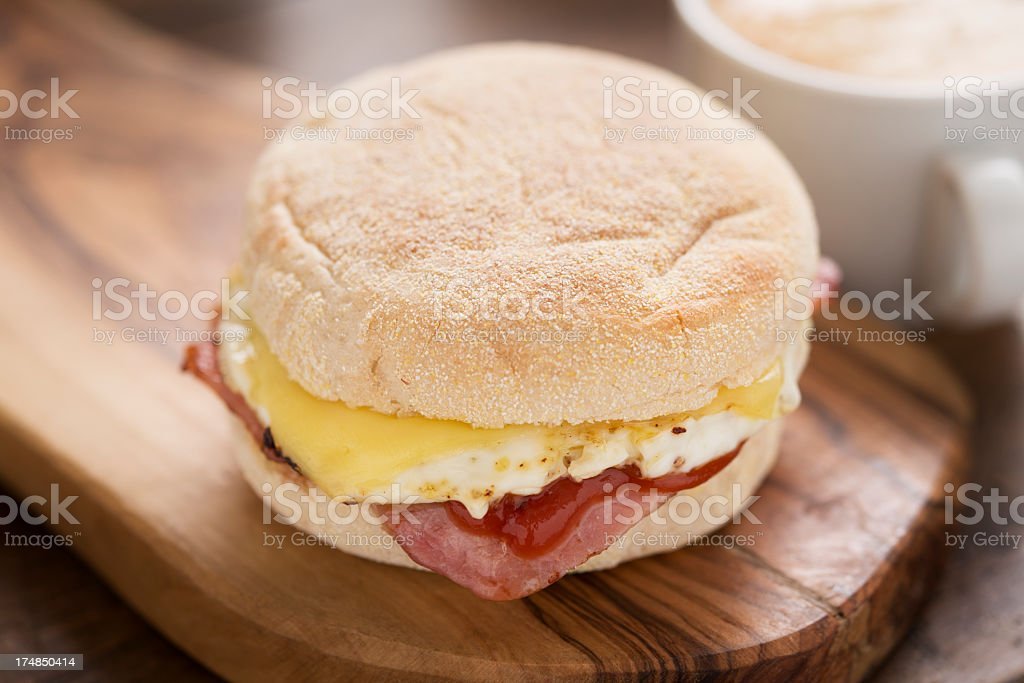 Breakfast Muffin with coffee in background. stock photo