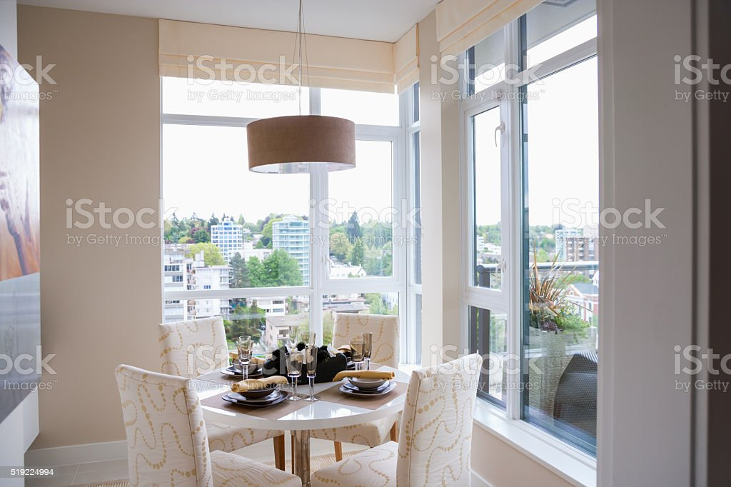 Breakfast nook surrounded by picture windows in condo stock photo