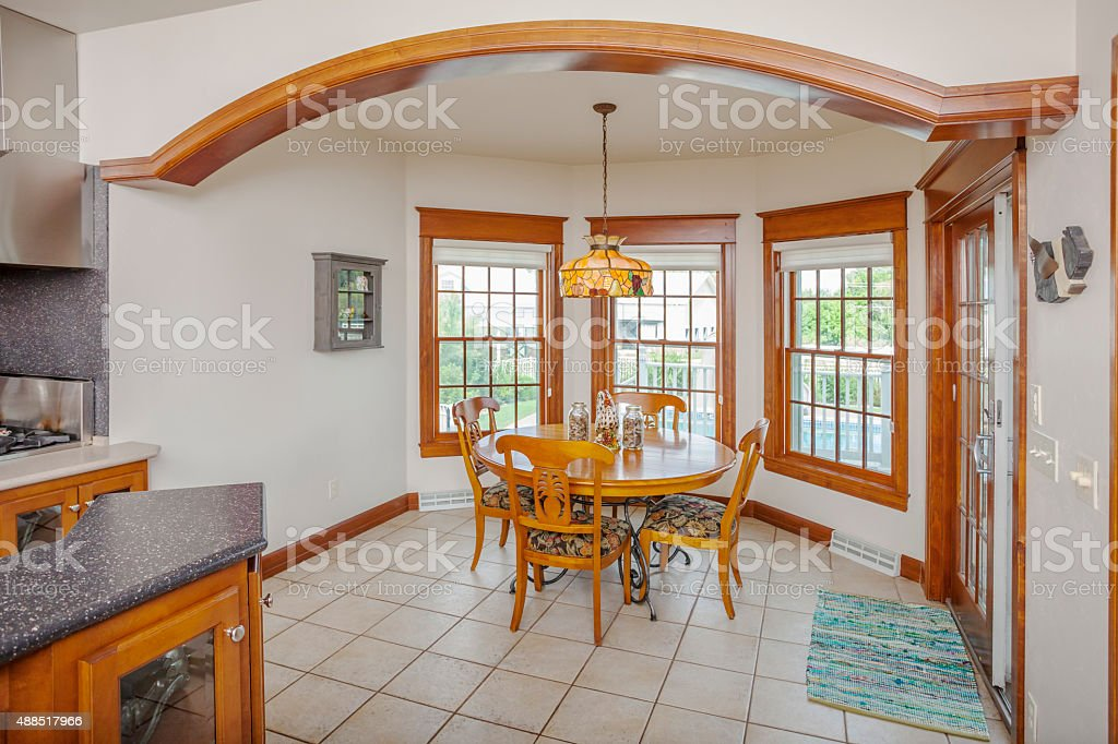 Breakfast nook with arch adjoining kitchen stock photo