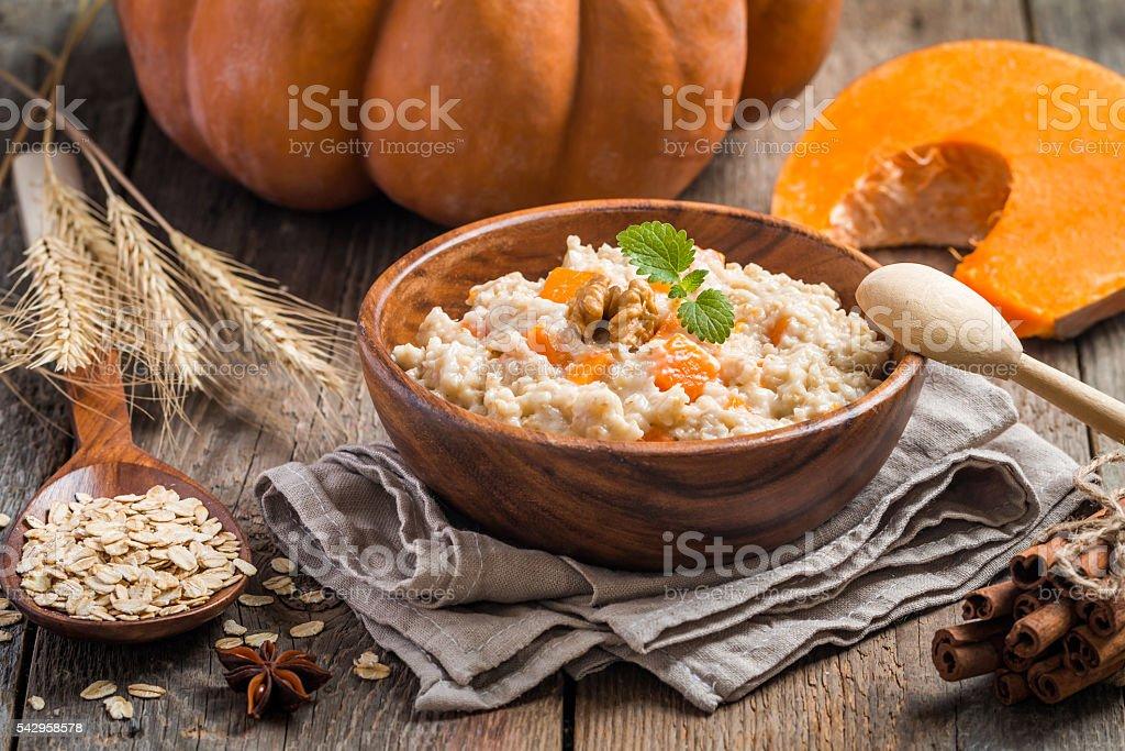 Breakfast oatmeal porridge with pumpkin stock photo