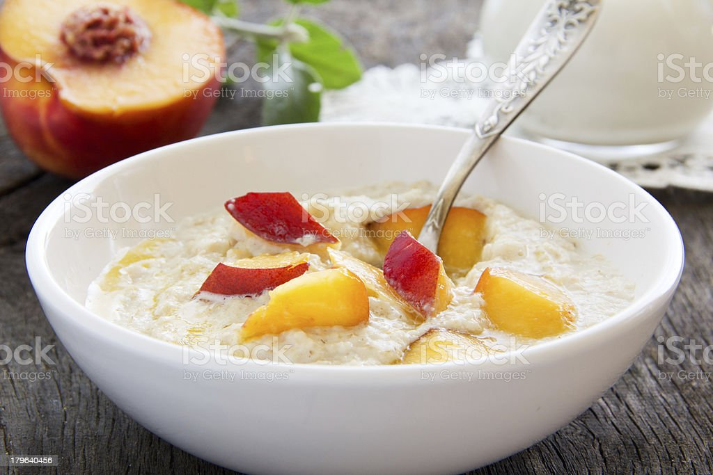 Breakfast, oatmeal with peaches. royalty-free stock photo