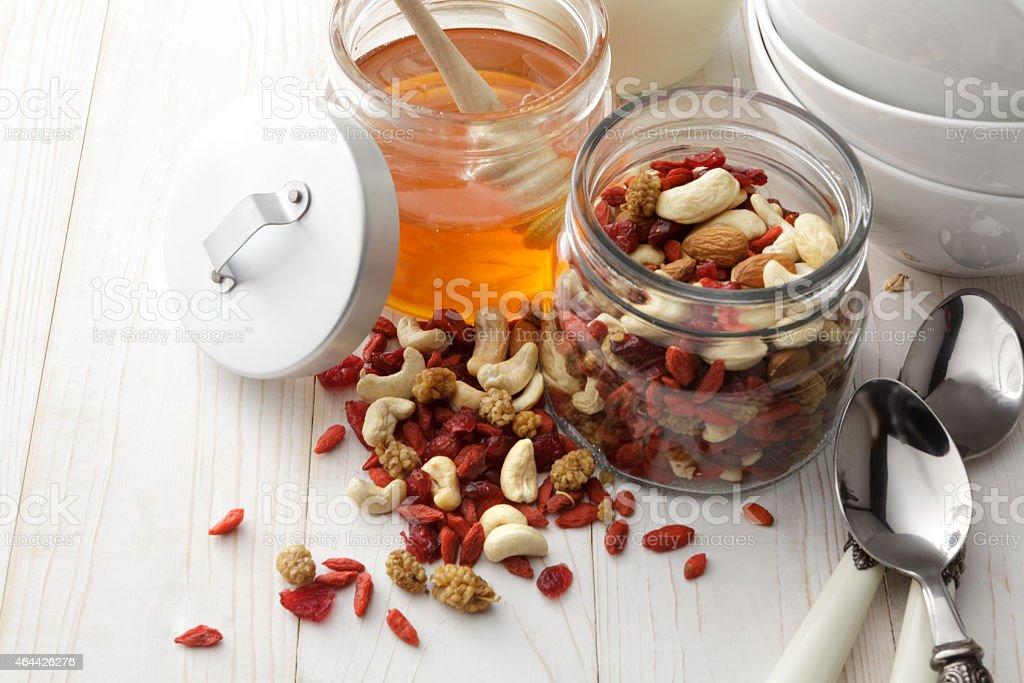 Breakfast: Oats, Trail Mix, Honey and Yogurt stock photo