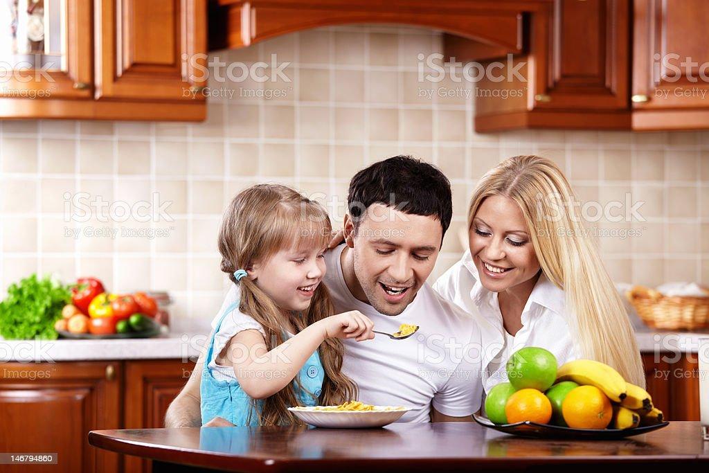 Breakfast of a happy family royalty-free stock photo