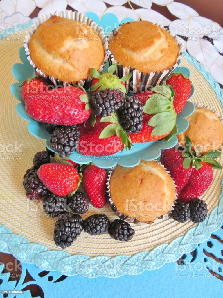 Breakfast of berries and muffins stock photo