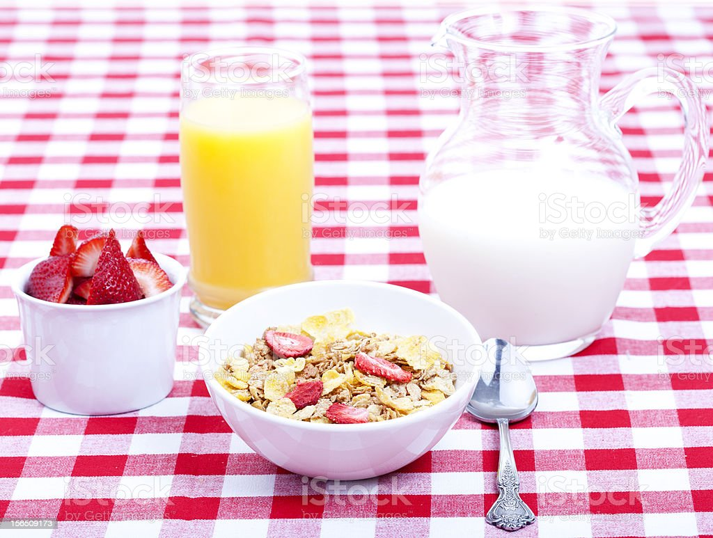 Breakfast of cereal, fruit, orange juice and milk royalty-free stock photo