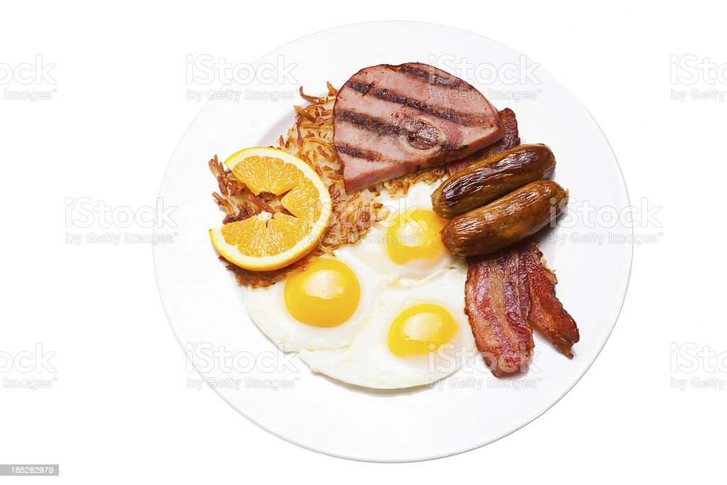 Breakfast of meats, eggs and potatos stock photo