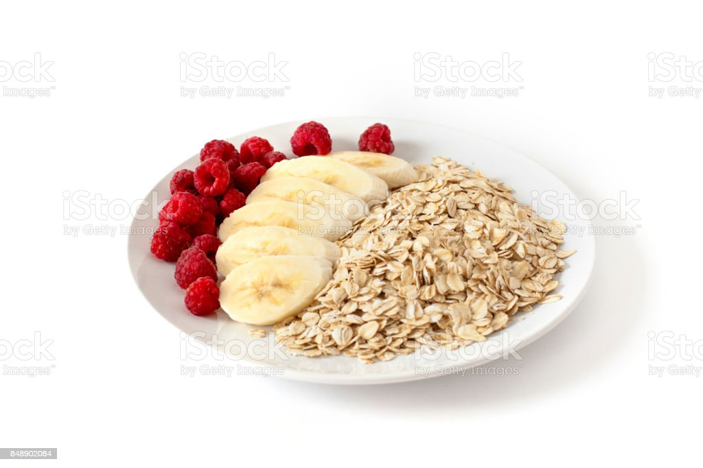 Breakfast of oatmeal with berries and bananas stock photo