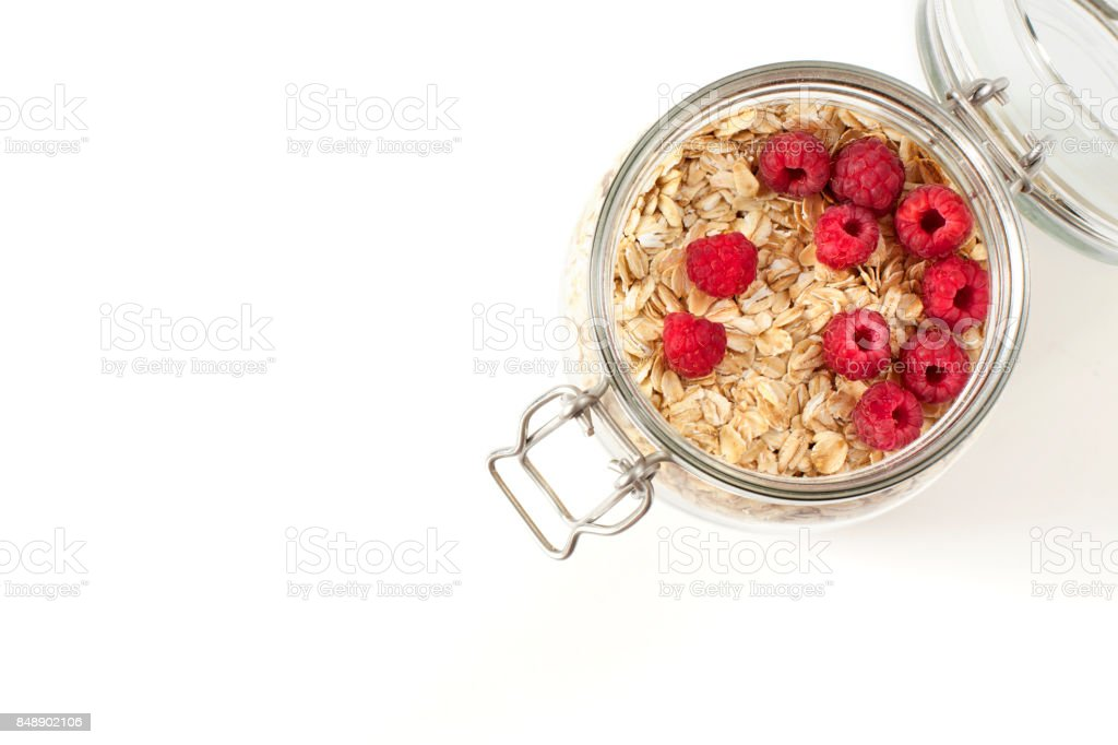Breakfast of oatmeal with berries in a jar stock photo