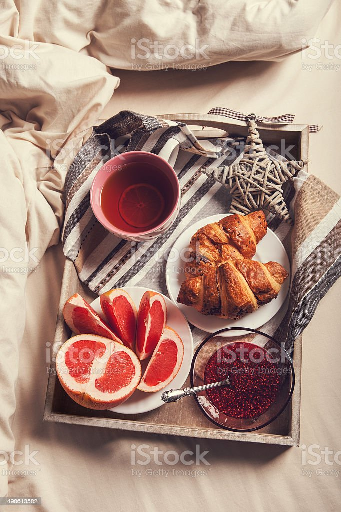 Breakfast on tray in morning bed stock photo