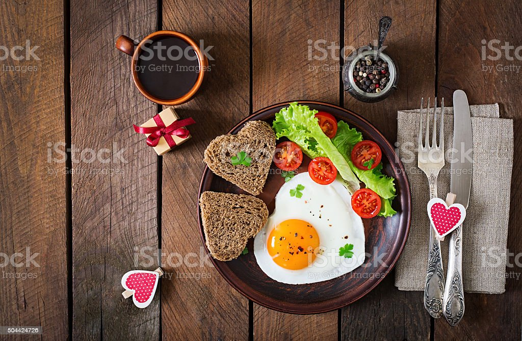 Breakfast on Valentine\'s Day - fried eggs and bread in the shape of a...