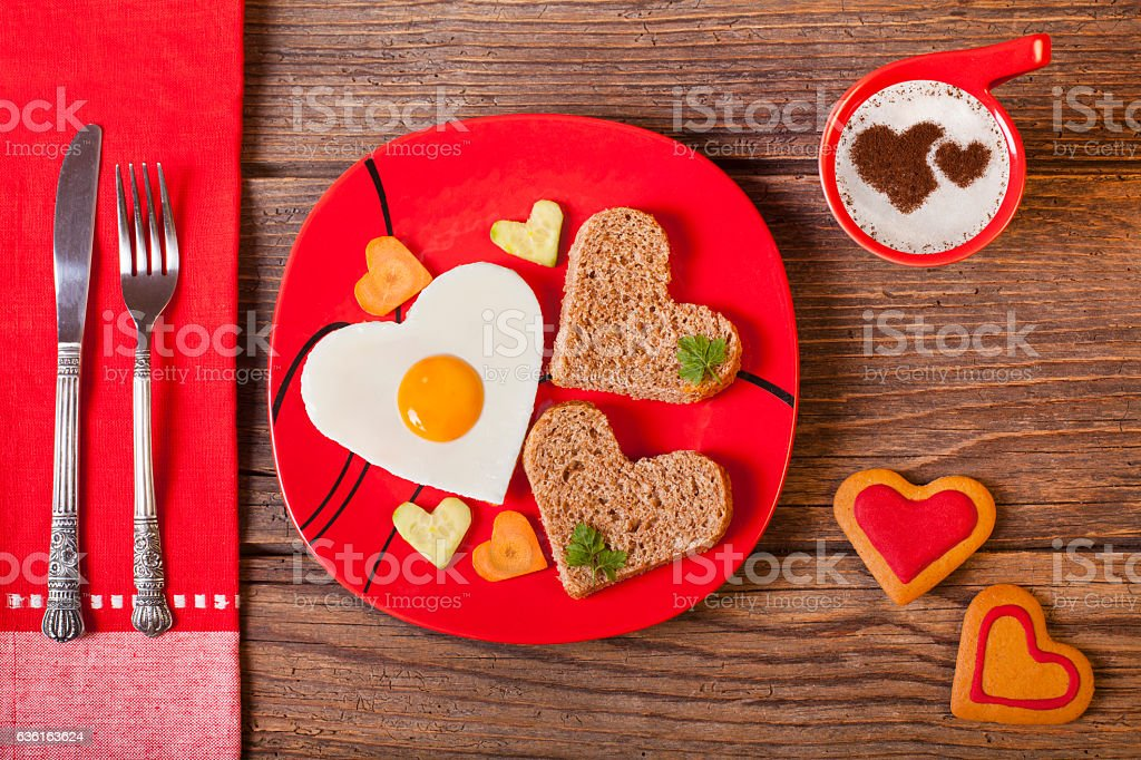 Breakfast on Valentine's Day on rustic wooden table. stock photo