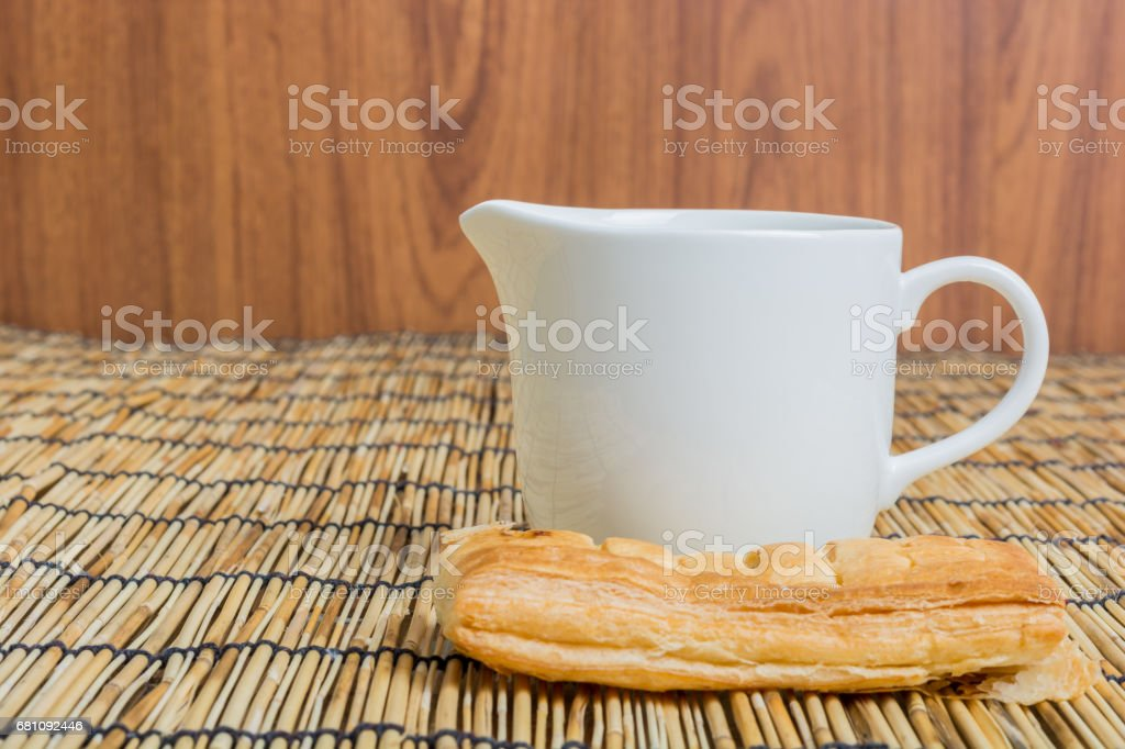 Breakfast pitcher of milk and bread stock photo
