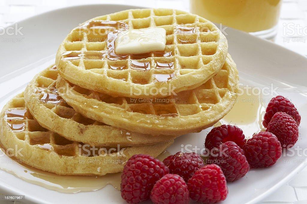 Breakfast plate of waffles and raspberries stock photo