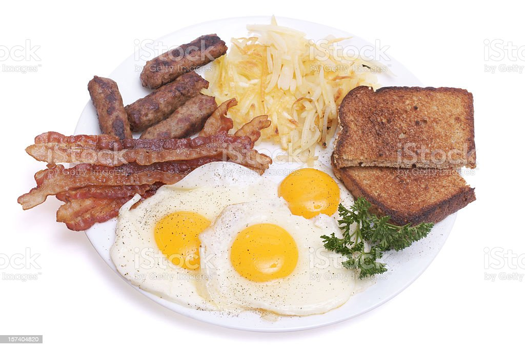 Breakfast plate with egg, sausage, bacon and toast. royalty-free stock photo