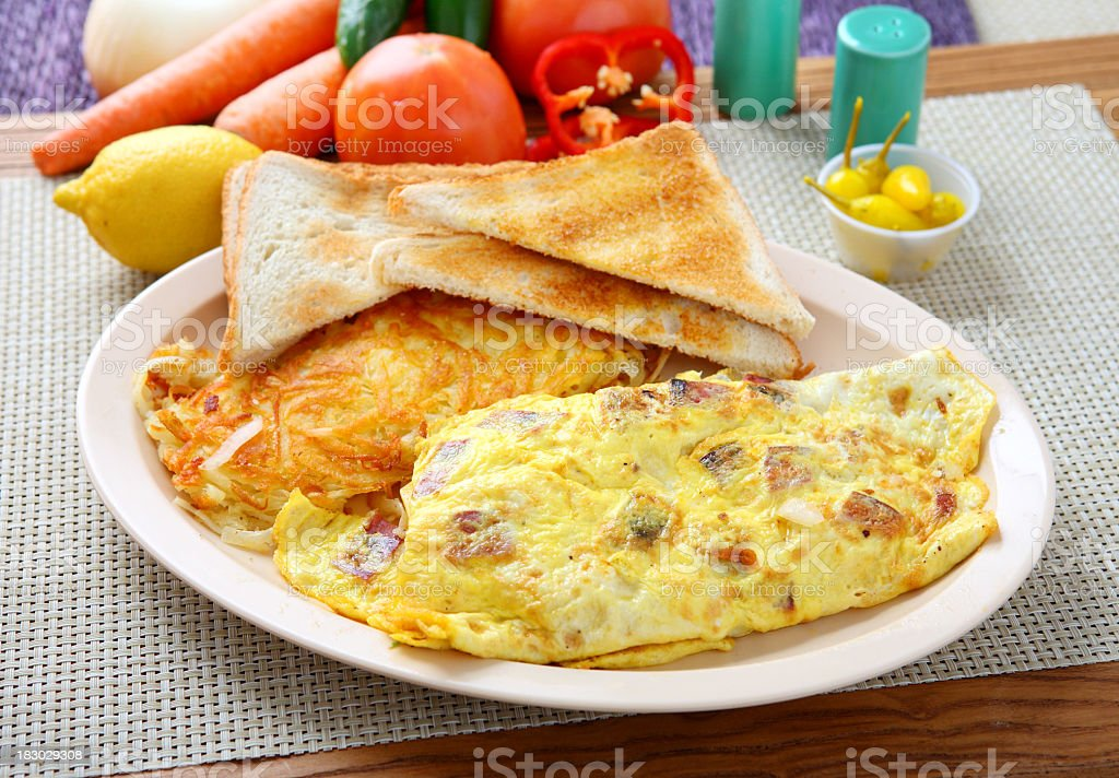 Breakfast platter with omelette, toast and hash browns stock photo