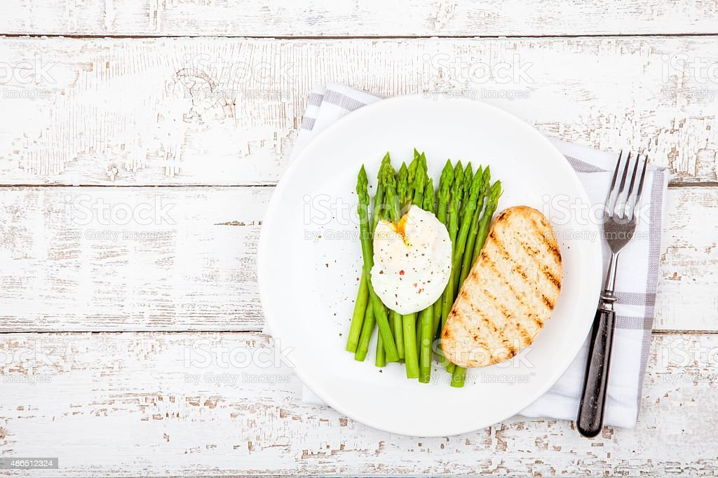 Breakfast: poached egg with asparagus and toasted ciabatta stock photo