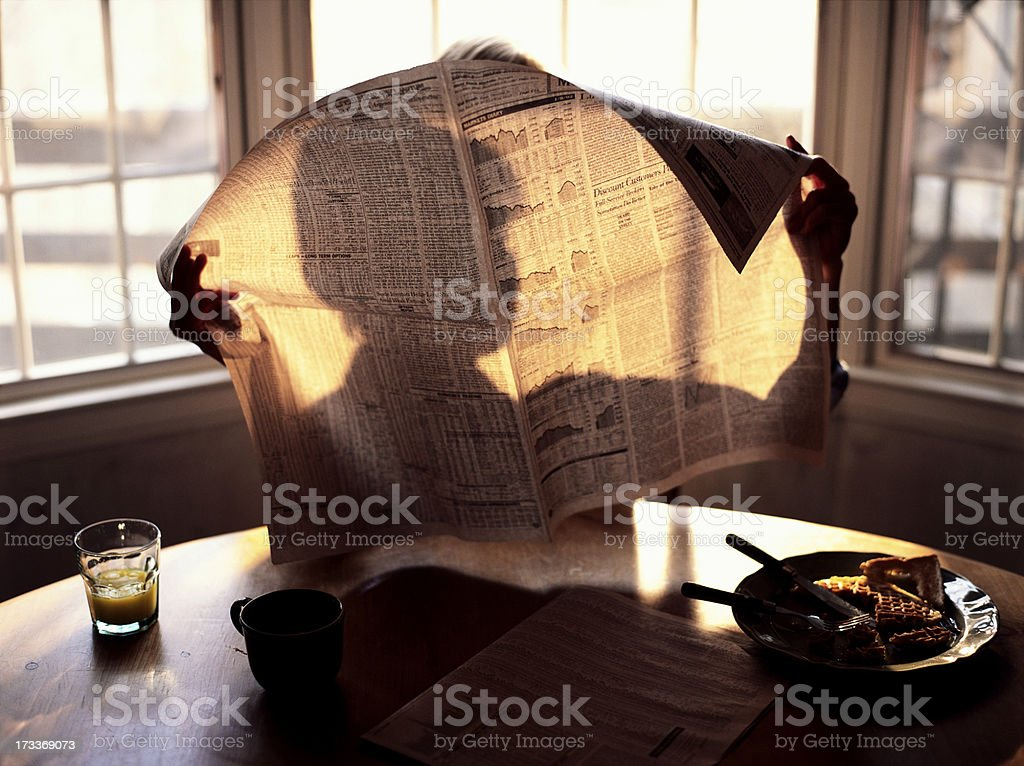 Breakfast Reading Morning Paper royalty-free stock photo