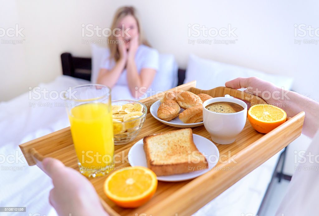 Breakfast served to bed. stock photo
