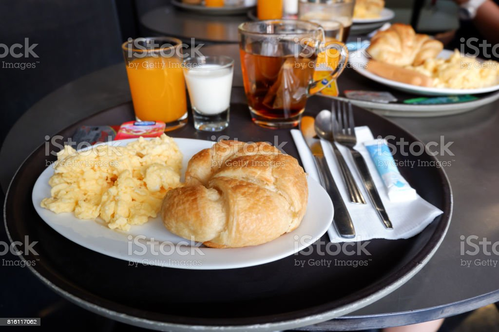 Breakfast served with Scrambled eggs, juice, Croissant in hotel, Thailand stock photo
