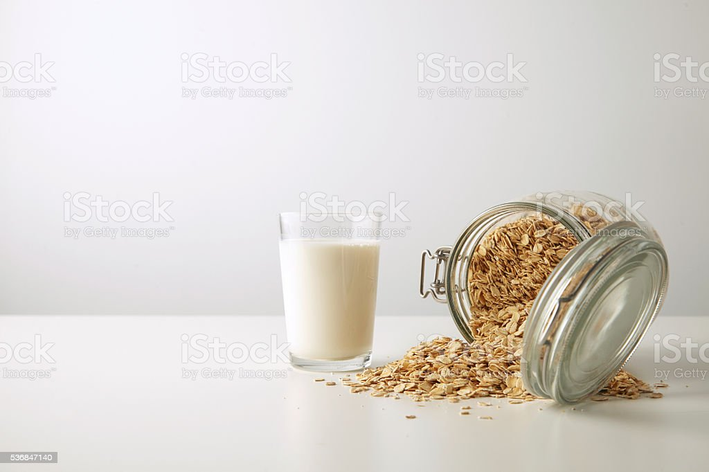 Breakfast set, rolled oats with milk stock photo