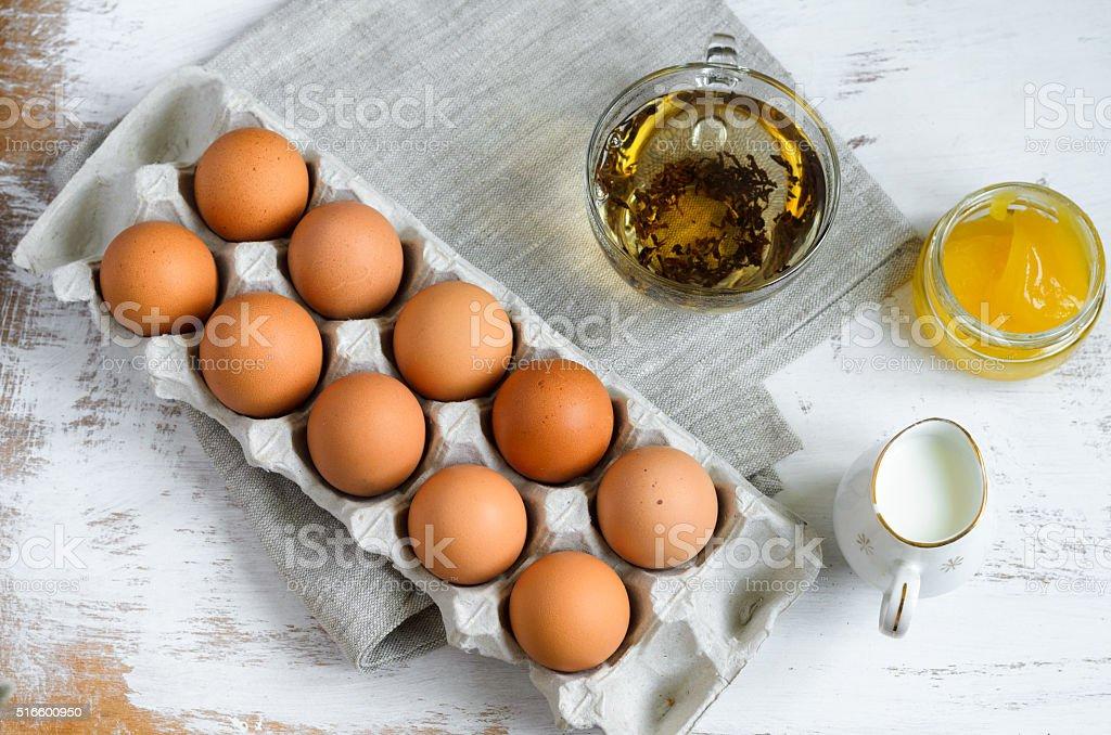 Breakfast setting - eggs and milk stock photo