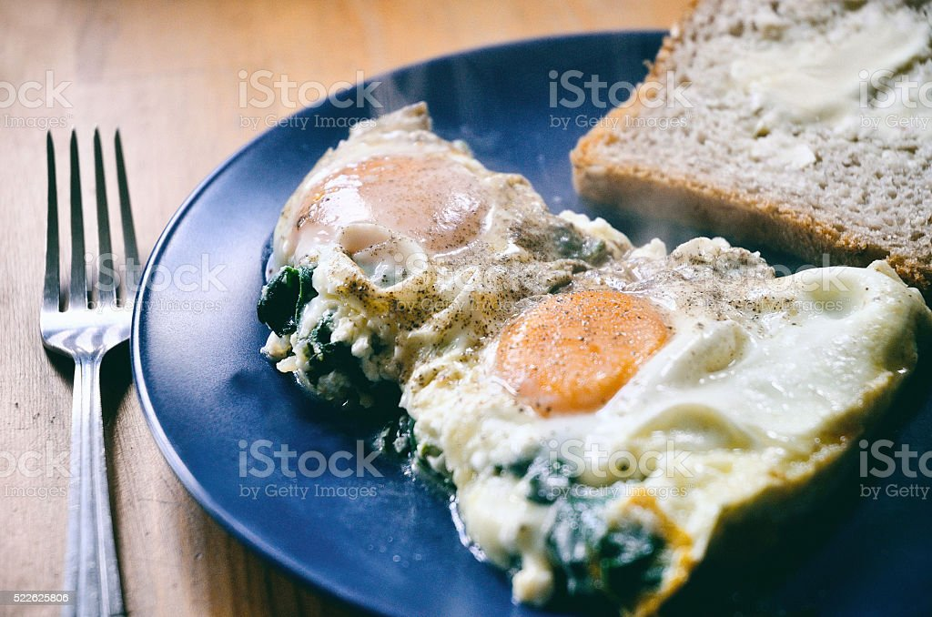 Breakfast - spinach shakshouka on a plate. stock photo