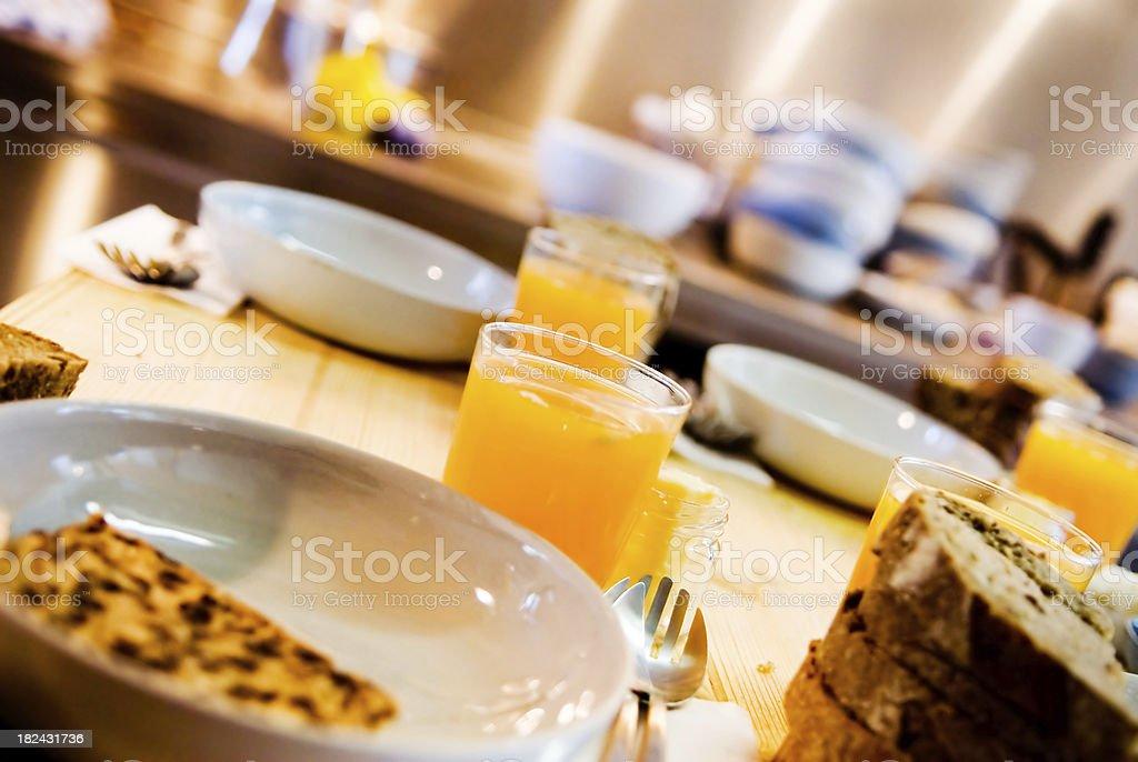 Breakfast table, bread and orange juice stock photo