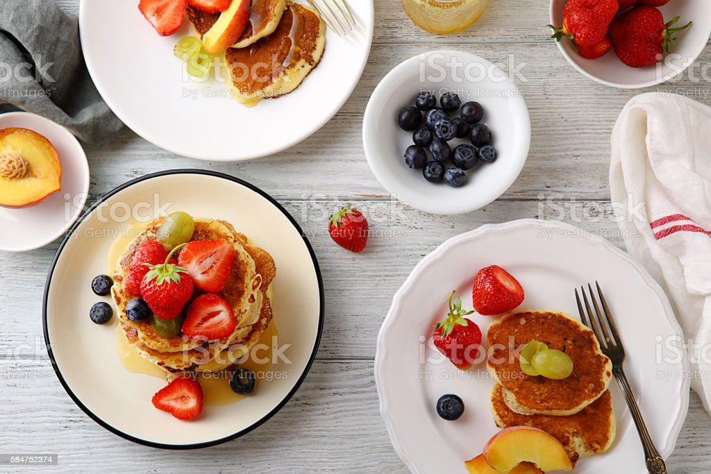 breakfast table set with pancakes stock photo