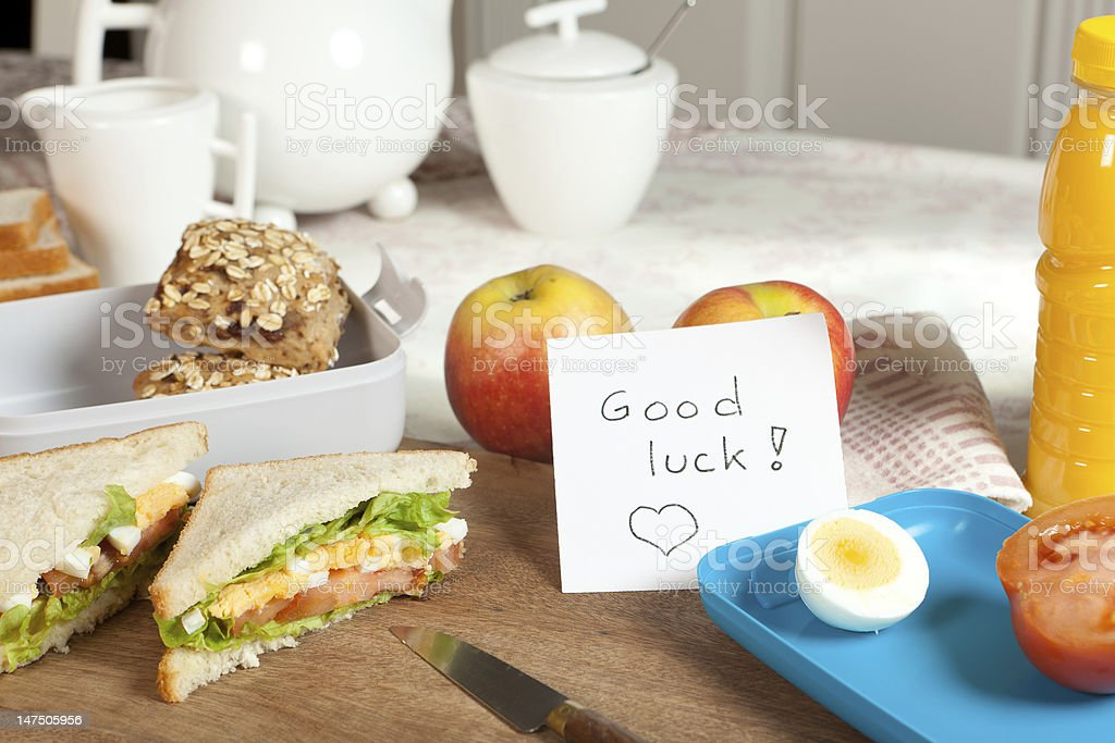 Breakfast table with good luck note royalty-free stock photo