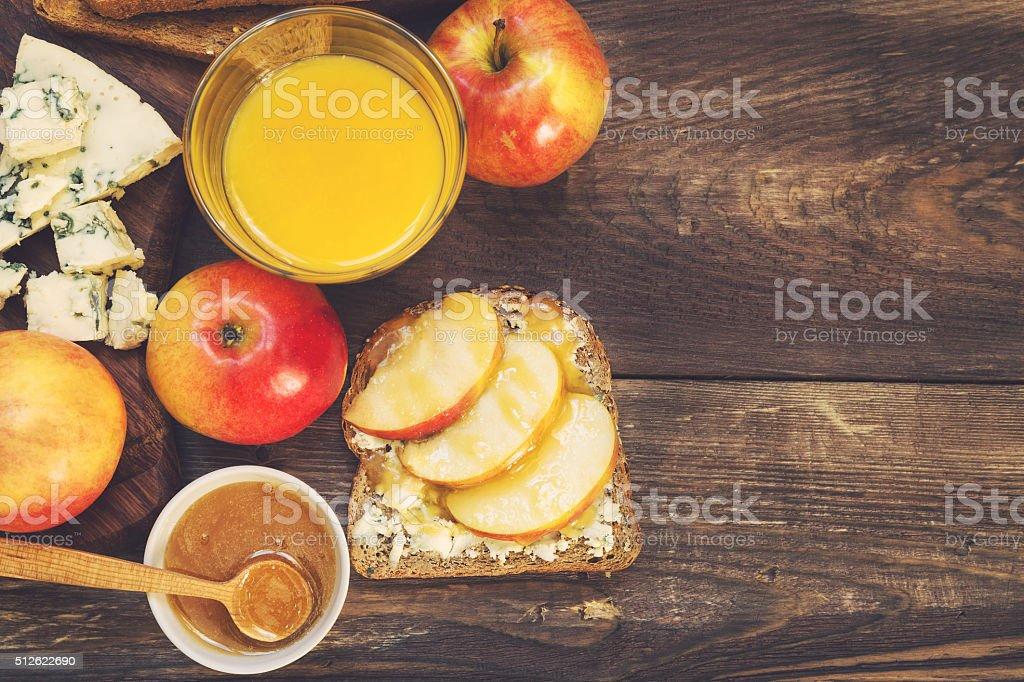 Breakfast toast with apple, honey and gorgonzola cheese stock photo