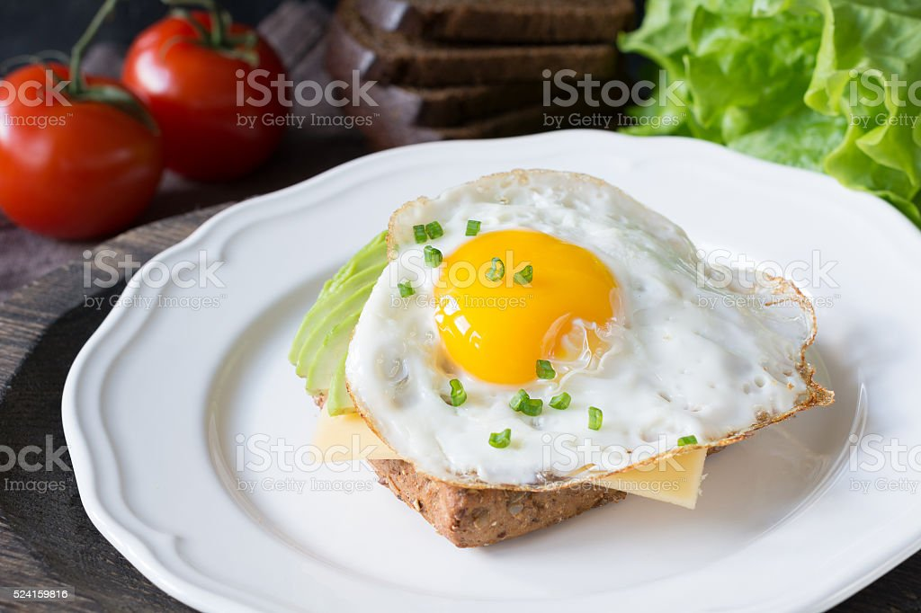 Breakfast toast with egg, avocado and cheese stock photo