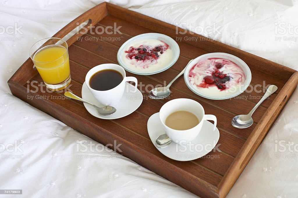 Breakfast tray with coffee and berries with cream stock photo