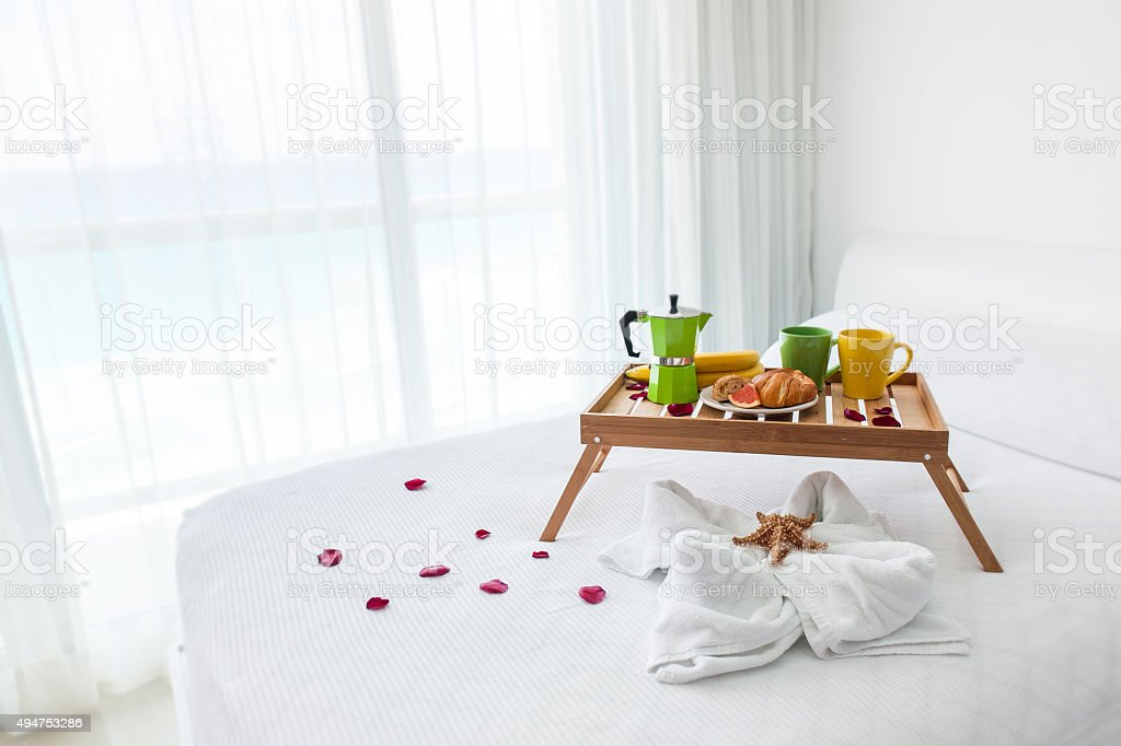 Breakfast tray with coffee on bed stock photo