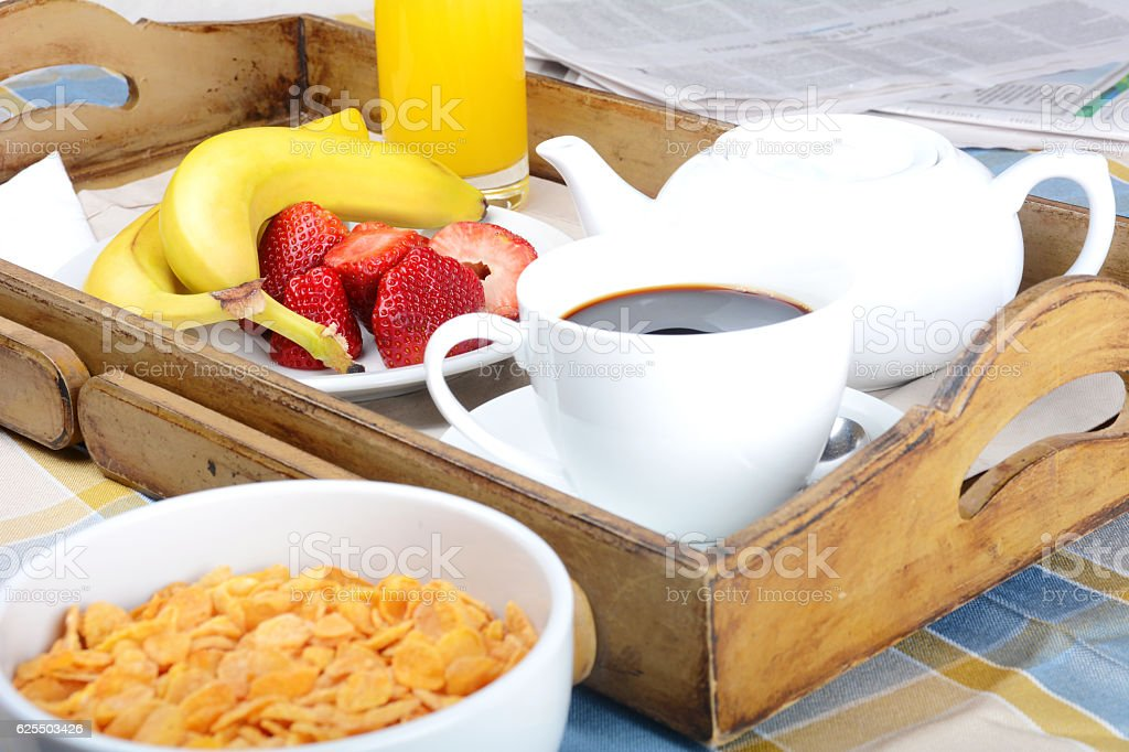 Breakfast tray with coffee, orange juice, cereals and fruits. stock photo
