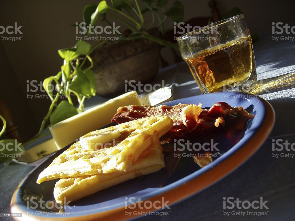 Breakfast - Waffles, Apple Juice and Bacon stock photo