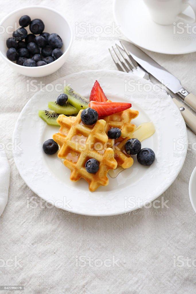 breakfast waffles with honey stock photo