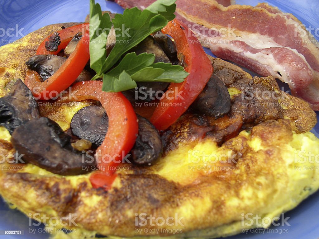 Breakfast - Wild mushroom omelette and bacon stock photo