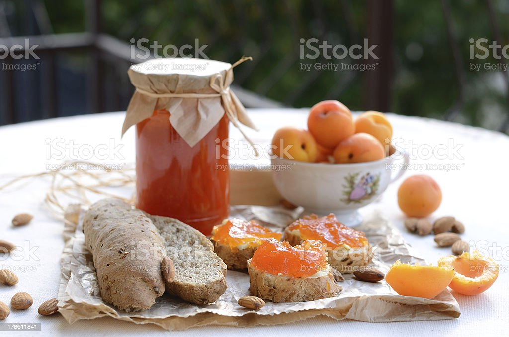 Breakfast with apricot jam, bread, fresh apricots and almonds royalty-free stock photo