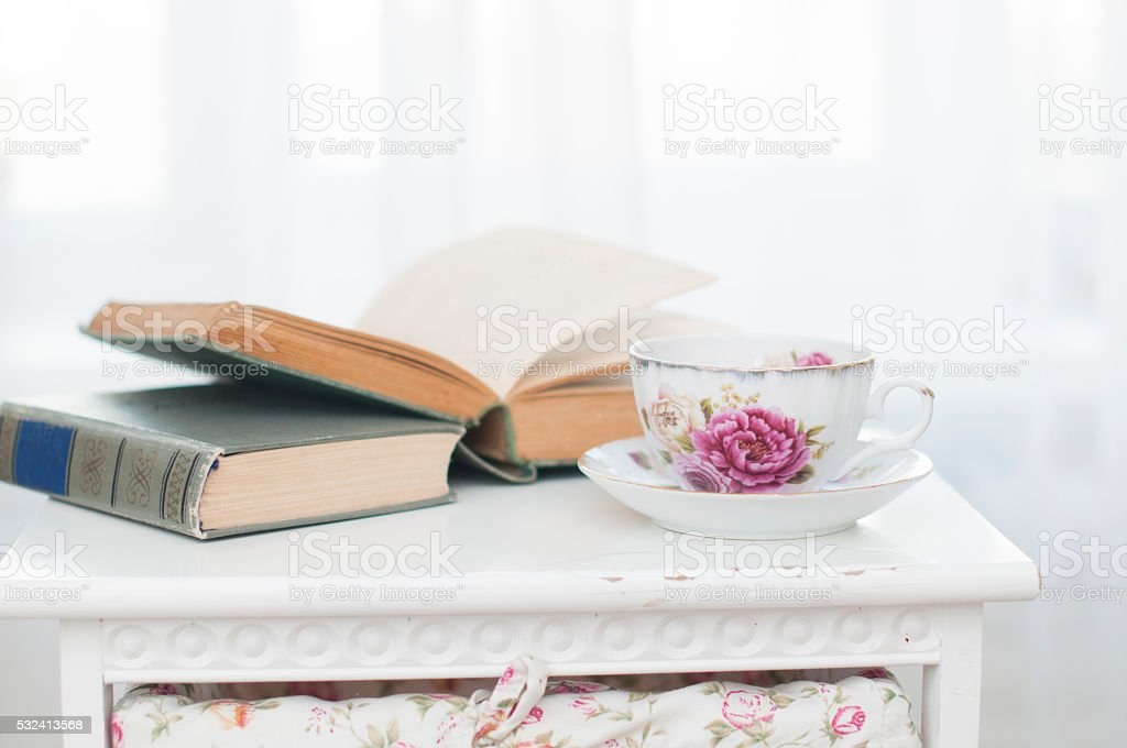 Breakfast with books and tea stock photo